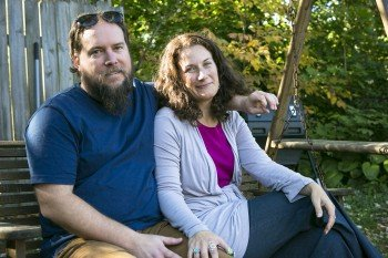Tom and Kirsten Hayes in the backyard of their new home