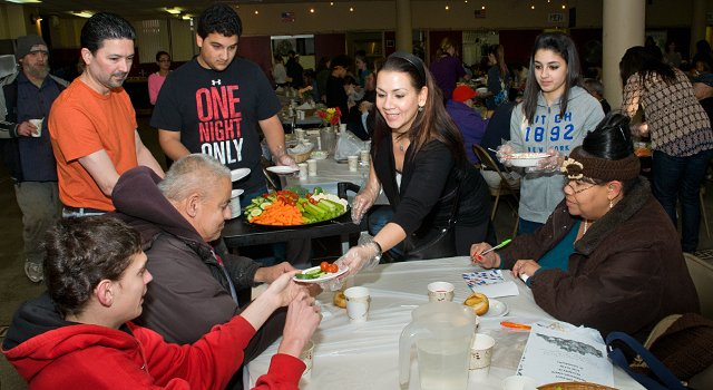 Volunteers serving at the Saint Colman's Church dinner for the needy