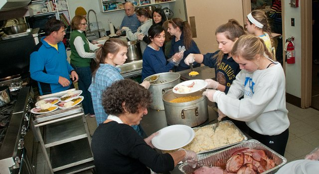 Kitchen volunteers at Saint Colman's Church dinner for the needy