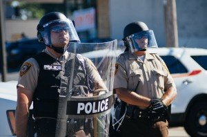 Police in riot gear at Ferguson, MO protests [photo credit: Jamelle Bouie, via Wikimedia Commons]