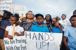 Protesters in Ferguson, MO [photo credit: Jamelle Bouie, via Wikimedia Commons]