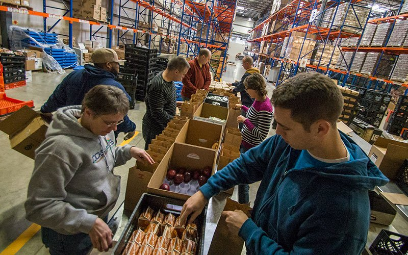Volunteers at the Cleveland Food Bank packing lunches for After School Programs
