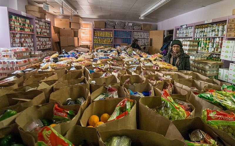 Jan Ridgeway with the bags of food ready for distribution at the Garden Valley Neighborhood House