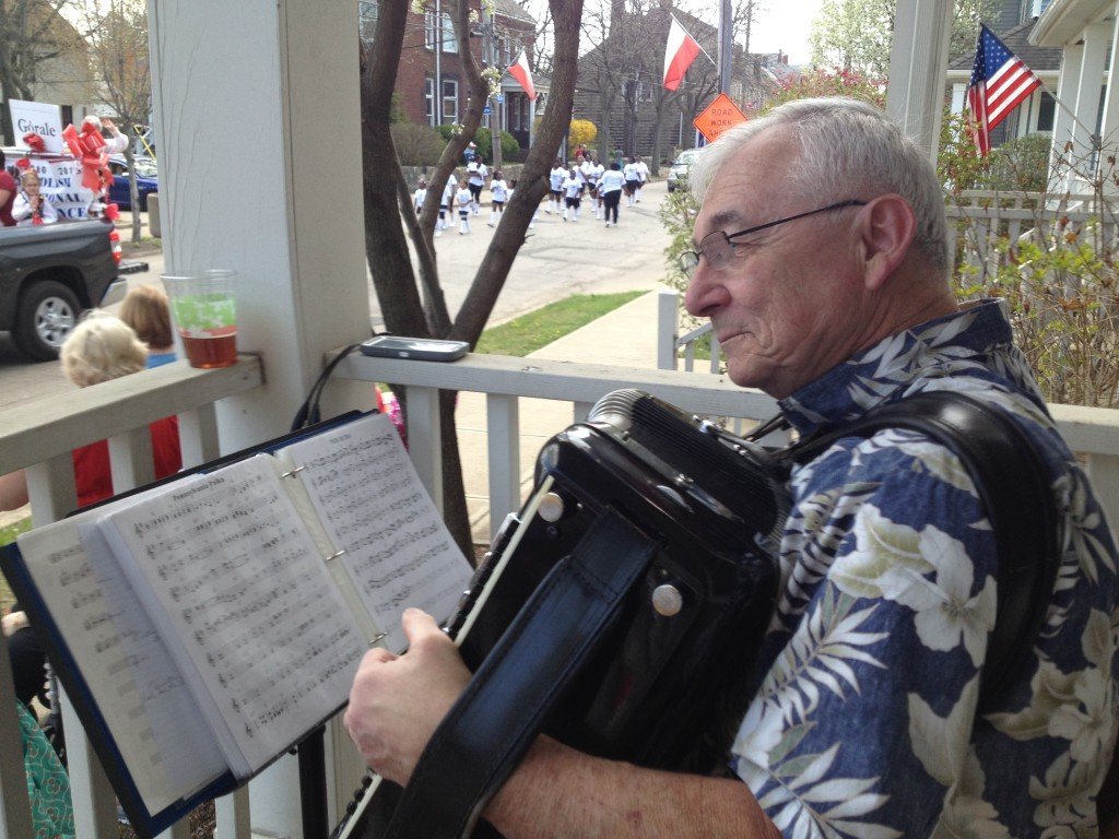 Pat Racut plays polka music on his accordion while watching a Polish heritage parade in Slavic Village [credit: Daniel J. McGraw]