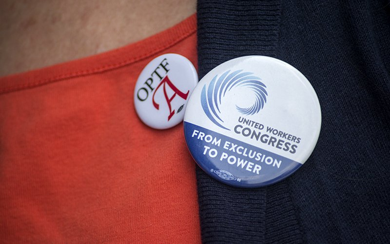 United Workers Congress button, which is a coalition of low-wage and temporary and migrant worker groups . The smaller button is for the Ohio Part-time Faculty Association
