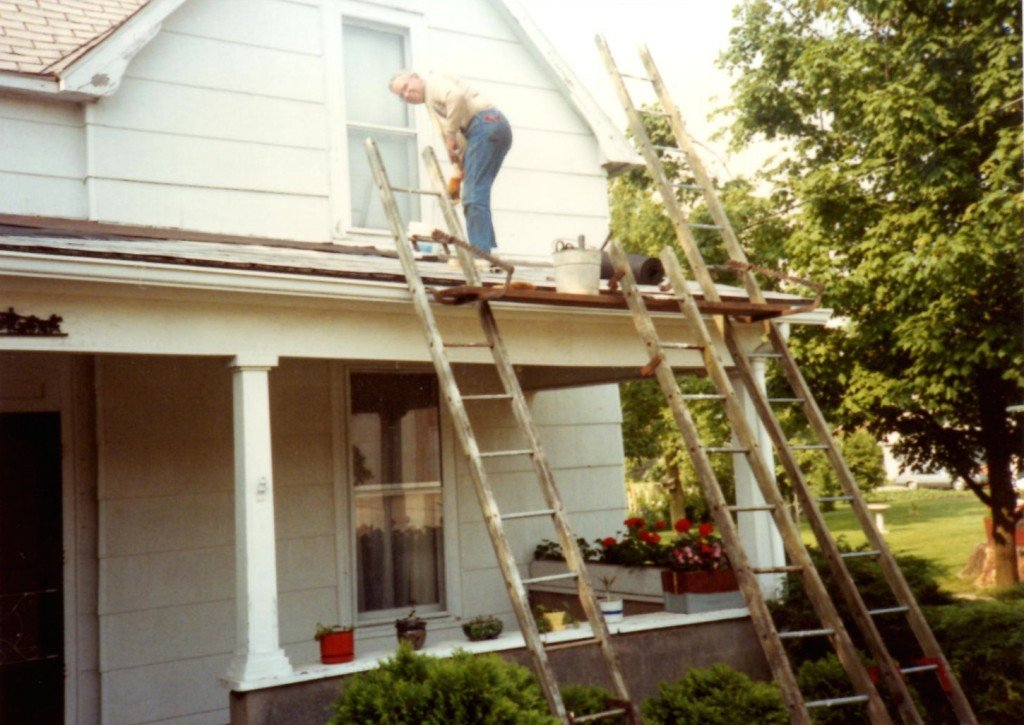 The author's grandfather, Ralph Swim, on the roof at 603 E. Wilson St.
