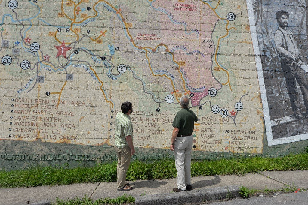 Bob Johnson and Mike Costello examine a mural depicting the Monongahela in Richwood. [credit: Arielle Milkman]