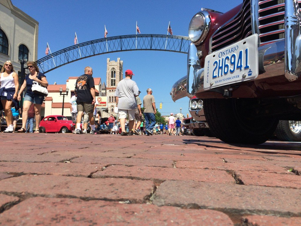 Thousands of people come out each year for Back to the Bricks, two weeks of car-related events taking place in and around Flint Michigan each August. The events culminate in a car show, seen here, in downtown Flint.