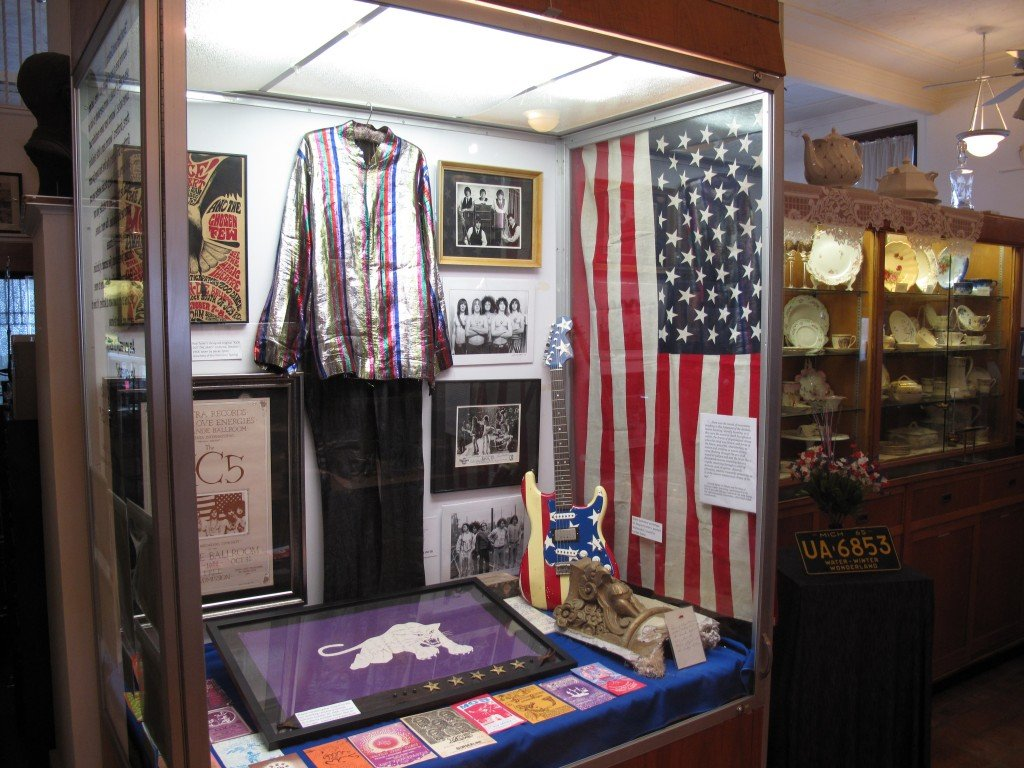 A scene from the museum, with Rob Tyner's outfit the dominant item in the display case. The china exhibit is to the right.