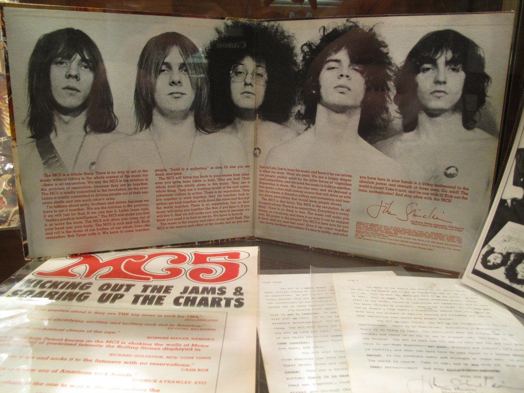 Another display case from the museum. The dominant item is the album.