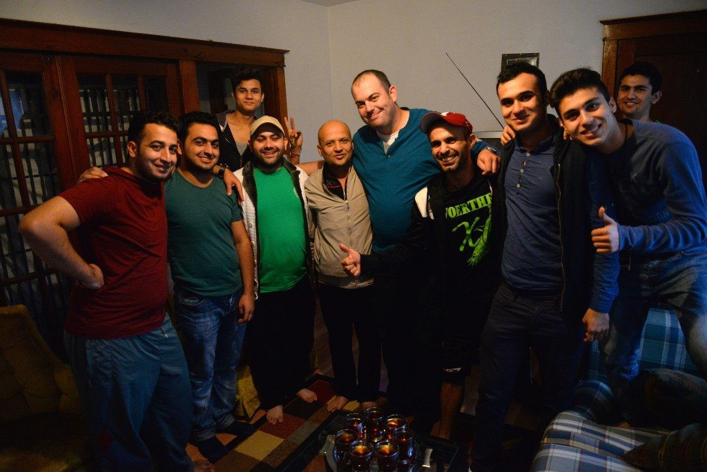 Dzemal Bijedic, center in the blue shirt, poses with Syrian refugees recently resettled in St. Louis.