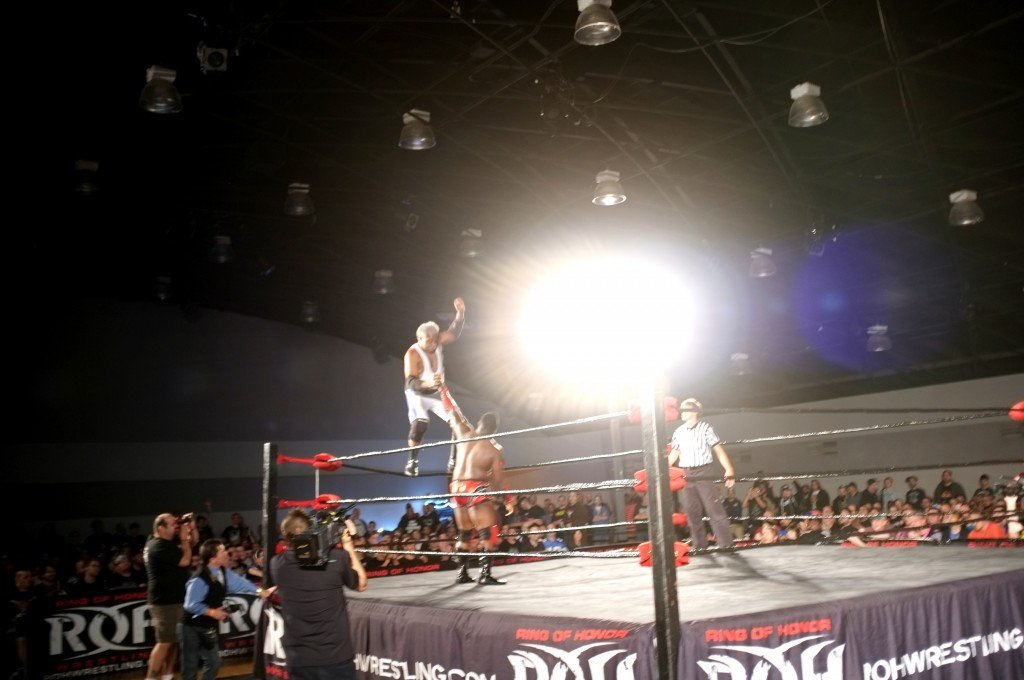 Leo Napier, wrestling as Father Time, raises his hand after walking the top rope during his debut in the Ring of Honor Sept. 11, 2015.