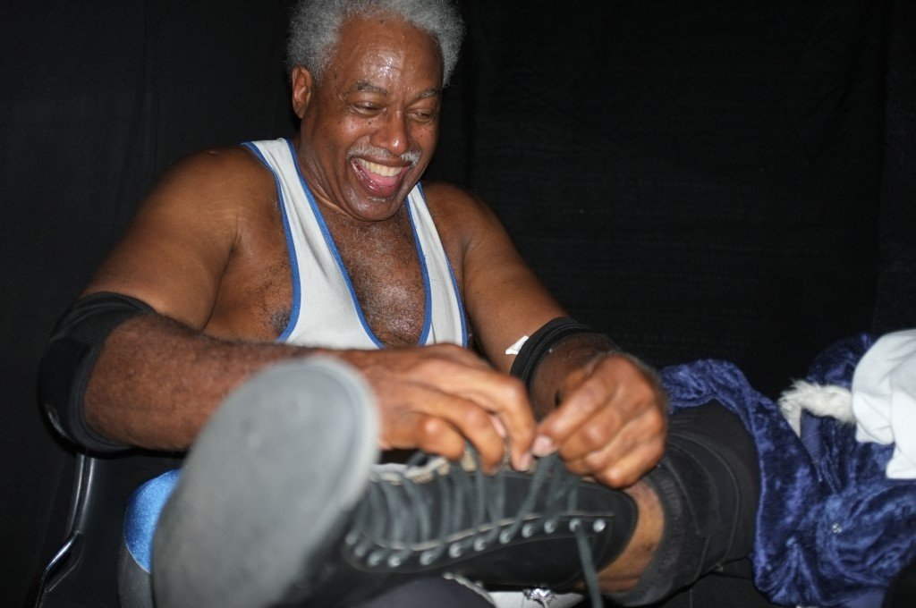 Leo Napier unlaces his boots after his debut match in the Ring of Honor in Dearborn, Michigan Sept. 11, 2015.