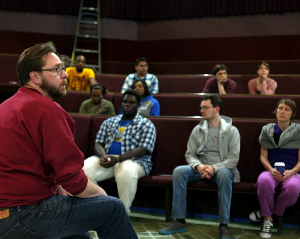"Flint Youth Theatre Executive Director Jeremy Winchester addresses the cast and crew before a rehearsal of ""The Most [Blank] City in America,"" an original play about Flint Michigan."