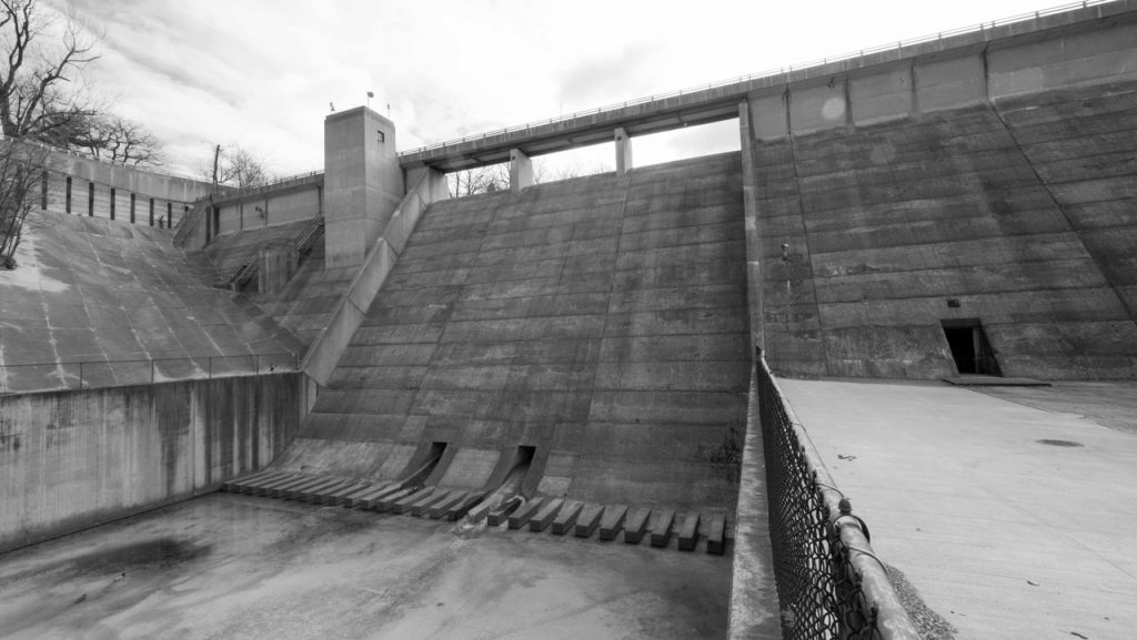 Situated in the center of Lakeview Cemetery, this concrete flood-control dam could probably best be described as architecture inspired by Joseph Stalin.