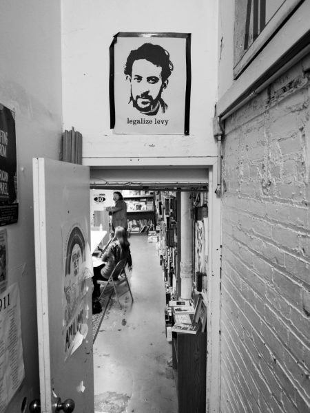 At Mac's Backs bookstore, the angular vestige of d.a. levy stares down at patrons as they make their way to the basement where poetry readings and workshops often take place.