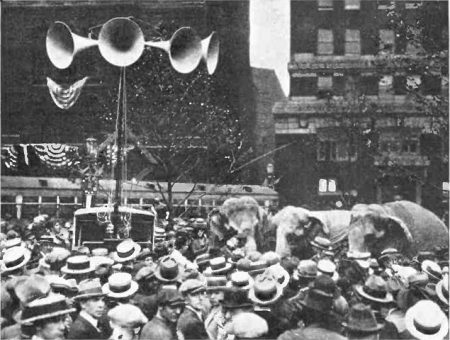 "Crowd outside the 1924 Republican National Convention in Cleveland listen to speeches broadcast from inside the hall via an early ""public address system."" From a 1924 issue of Popular Radio magazine."