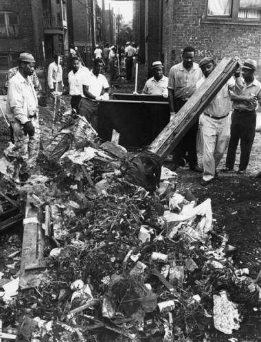 Hough residents clean up after the 1966 riots. Photo: Cleveland State University, Michael Schwartz Library, Cleveland Press Collection.