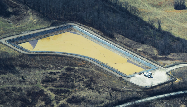 "Hydraulic fracturing liquid wastewater impoundment, known as the ""Cowgill Impoundment."""