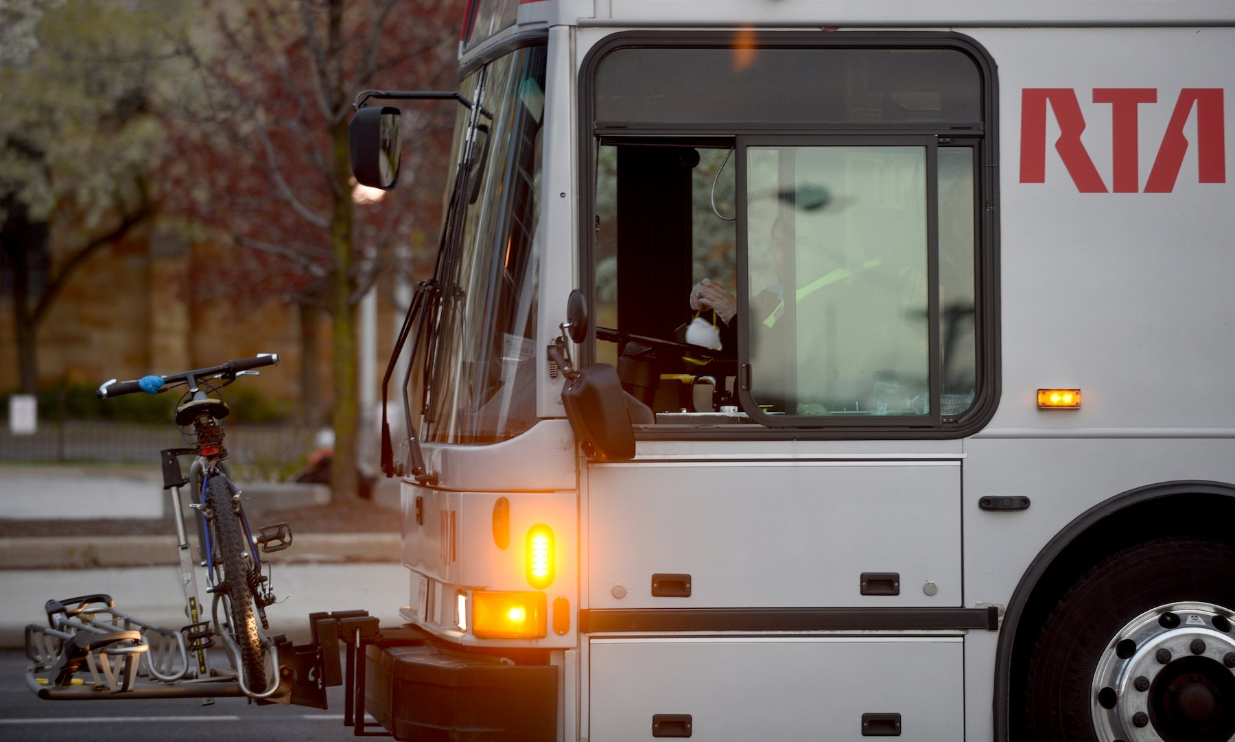 An RTA bus driver adjusts their mask Wednesday, April 29, in Cleveland, Ohio. Photo by Tim Harrison for Belt Magazine.