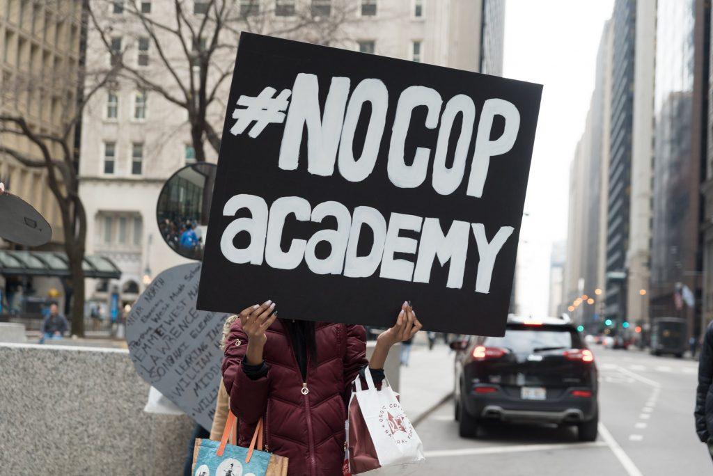 Love + Struggle - No Cop Academy March